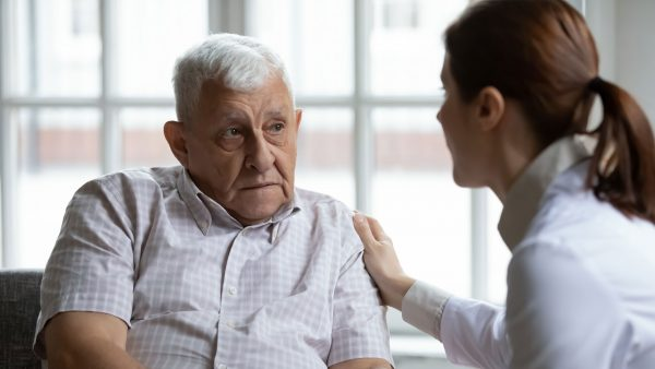 Elderly man getting bad news from his doctor